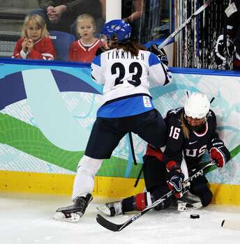 VANCOUVER, BC - FEBRUARY 18:  Nina Tikkinen of Finland battles for the puck with Kelli Stack of The United States during the ice hockey women's preliminary game between USA and Finland on day 7 of the 2010 Vancouver Winter Olympics at UBC Thunderbird Arena on February 18, 2010 in Vancouver, Canada.  (Photo by Harry How/Getty Images) *** Local Caption *** Kelli Stack;Nina Tikkinen Photo: Harry How, Getty Images / 2010 Getty Images