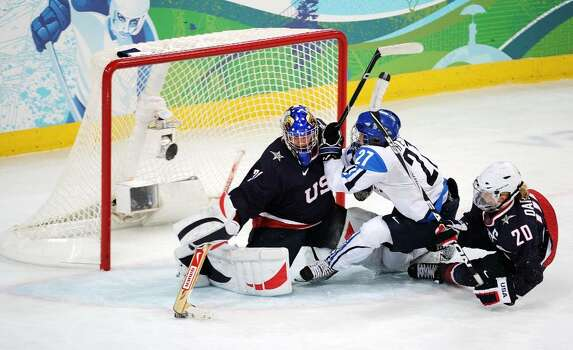 VANCOUVER, BC - FEBRUARY 18:  Goalkeeper Jessie Vetter of the United States makes a save during the ice hockey women's preliminary game between USA and Finland on day 7 of the 2010 Vancouver Winter Olympics at UBC Thunderbird Arena on February 18, 2010 in Vancouver, Canada.  (Photo by Harry How/Getty Images) *** Local Caption *** Jessie Vetter Photo: Harry How, Getty Images / 2010 Getty Images