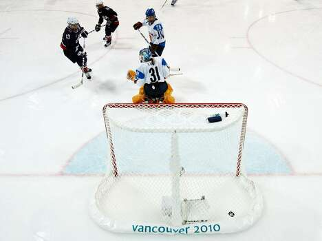 VANCOUVER, BC - FEBRUARY 18:  USA scores past Noora Raty of Finland during the ice hockey women's preliminary game between USA and Finland on day 7 of the 2010 Vancouver Winter Olympics at UBC Thunderbird Arena on February 18, 2010 in Vancouver, Canada.  (Photo by Harry How/Getty Images) *** Local Caption *** Noora Raty Photo: Harry How, Getty Images / 2010 Getty Images