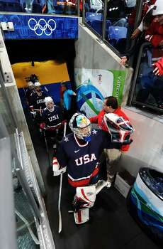 VANCOUVER, BC - FEBRUARY 18: The United States team walk out for the ice hockey women's preliminary game between USA and Finland on day 7 of the 2010 Vancouver Winter Olympics at UBC Thunderbird Arena on February 18, 2010 in Vancouver, Canada.  (Photo by Harry How/Getty Images) Photo: Harry How, Getty Images / 2010 Getty Images