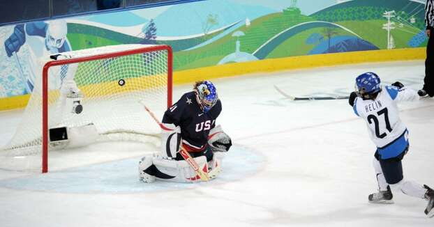 VANCOUVER, BC - FEBRUARY 18:  Anne Helin of Finland makes a shot on goal during the ice hockey women's preliminary game between USA and Finland on day 7 of the 2010 Vancouver Winter Olympics at UBC Thunderbird Arena on February 18, 2010 in Vancouver, Canada.  (Photo by Harry How/Getty Images) *** Local Caption *** Anne Helin Photo: Harry How, Getty Images / 2010 Getty Images