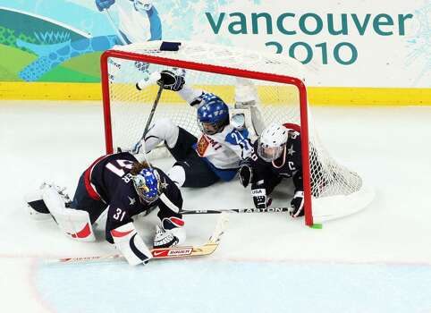 VANCOUVER, BC - FEBRUARY 18:  Players crash into the goal during the ice hockey women's preliminary game between USA and Finland on day 7 of the 2010 Vancouver Winter Olympics at UBC Thunderbird Arena on February 18, 2010 in Vancouver, Canada.  (Photo by Harry How/Getty Images) Photo: Harry How, Getty Images / 2010 Getty Images