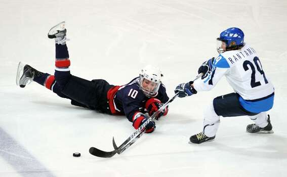 VANCOUVER, BC - FEBRUARY 18:  Meghan Duggan of the United States battles for the puck with Karoliina Rantamaki of Finland during the ice hockey women's preliminary game between USA and Finland on day 7 of the 2010 Vancouver Winter Olympics at UBC Thunderbird Arena on February 18, 2010 in Vancouver, Canada.  (Photo by Harry How/Getty Images) *** Local Caption *** Karoliina Rantamaki;Meghan Duggan Photo: Harry How, Getty Images / 2010 Getty Images