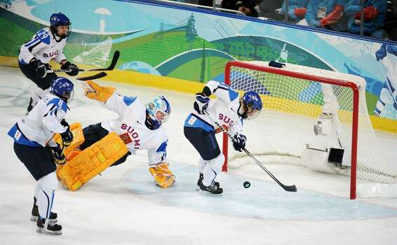 VANCOUVER, BC - FEBRUARY 18:  Emma Laaksonen of Finland stops the puck going into goal during the ice hockey women's preliminary game between USA and Finland on day 7 of the 2010 Vancouver Winter Olympics at UBC Thunderbird Arena on February 18, 2010 in Vancouver, Canada.  (Photo by Harry How/Getty Images) *** Local Caption *** Emma Laaksonen Photo: Harry How, Getty Images / 2010 Getty Images