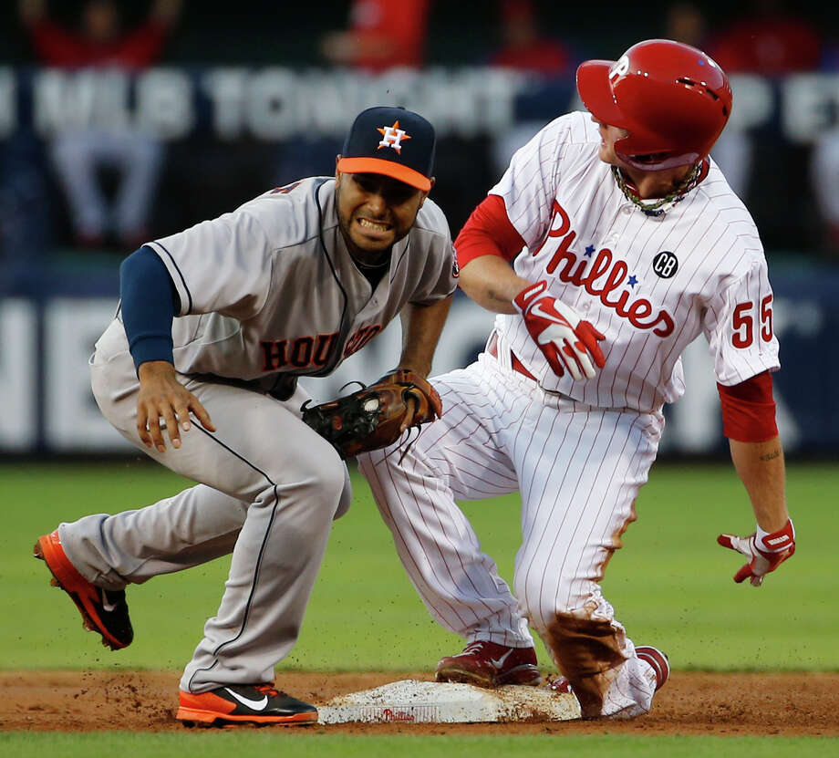 Astros shortstop Gregorio Petit, left, tags out the Phillies' David Buchanan, who tried to advance after driving in the final run in a five-run first inning Wednesday. Photo: Matt Slocum, STF / AP