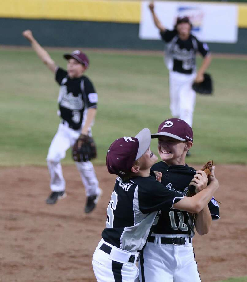 Brandon Sliwinski, front left, and Landon Donley lead the celebration of the 7-3 victory over Louisiana that gave Pearland the Southwest Regional title and a trip to Williamsport, Pa., for the Little League World Series beginning Aug. 14 Photo: Rod Aydelotte, MBO / Waco Tribune Herald