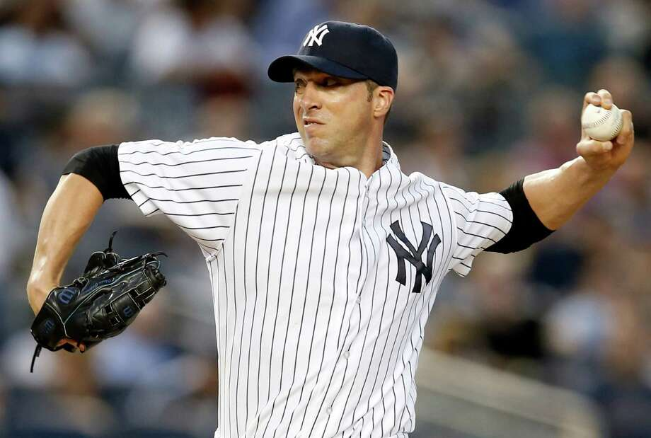 New York Yankees starting pitcher Chris Capuano delivers in the third inning of a baseball game against the Detroit Tigers at Yankee Stadium in New York, Wednesday, Aug. 6, 2014.  (AP Photo/Kathy Willens) ORG XMIT: NYY115 Photo: Kathy Willens / AP