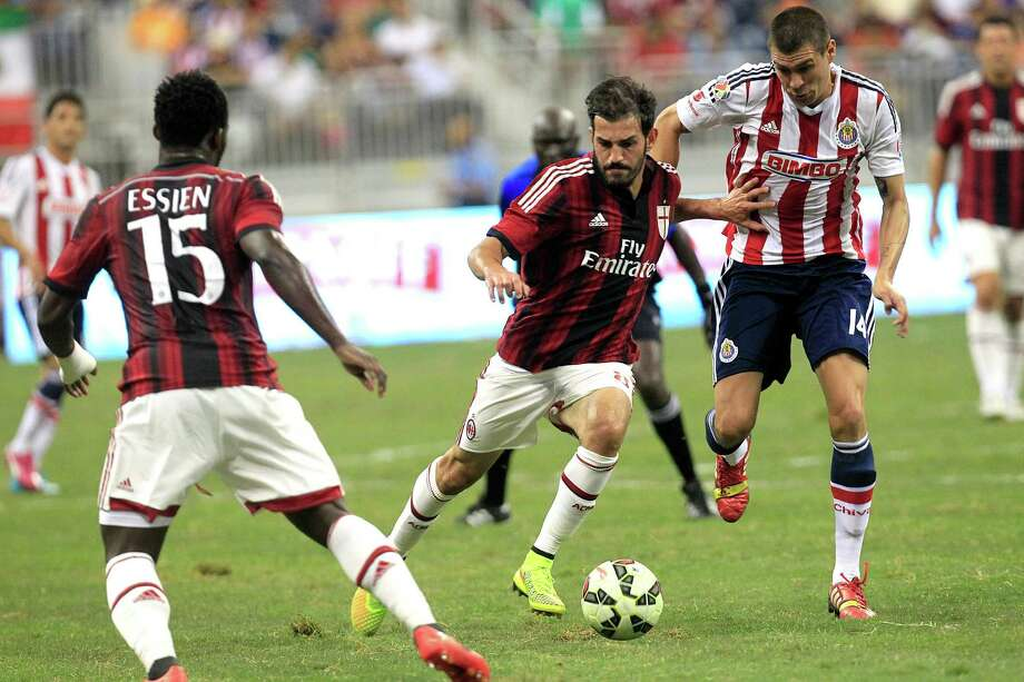 A.C. Milan midfielder Riccardo Saponara (8) and Chivas midfielder Jorge Enriquez (14) battle for the ball in the second half as A.C. Milan defeated Chivas de Guadalajara 3-0 in an international friendly soccer game at NRG Stadium Wednesday, Aug. 6, 2014, in Houston. Photo: Johnny Hanson, Houston Chronicle / © 2014  Houston Chronicle
