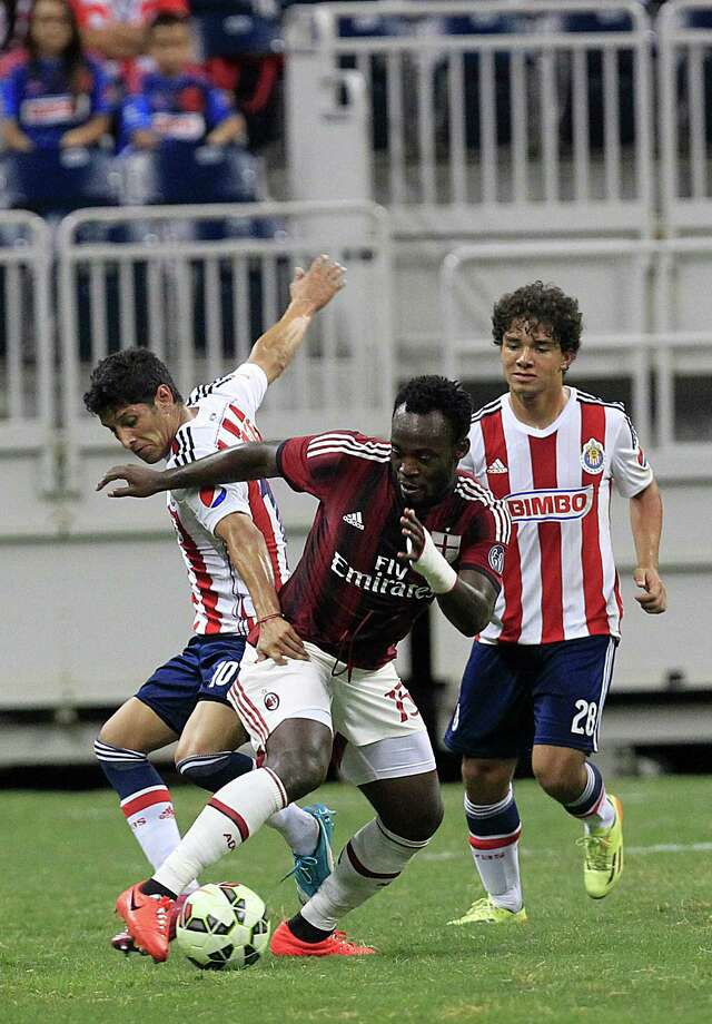 A.C. Milan midfielder Michael Essien (15) and Chivas forward Angel Reyna (10) battle for the ball in the second half as A.C. Milan defeated Chivas de Guadalajara 3-0 in an international friendly soccer game at NRG Stadium Wednesday, Aug. 6, 2014, in Houston. Photo: Johnny Hanson, Houston Chronicle / © 2014  Houston Chronicle