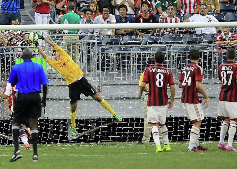 A.C. Milan goal keeper Michael Agazzi (1)  makes a save in the second half as A.C. Milan defeated Chivas de Guadalajara 3-0 in an international friendly soccer game at NRG Stadium Wednesday, Aug. 6, 2014, in Houston. Photo: Johnny Hanson, Houston Chronicle / © 2014  Houston Chronicle