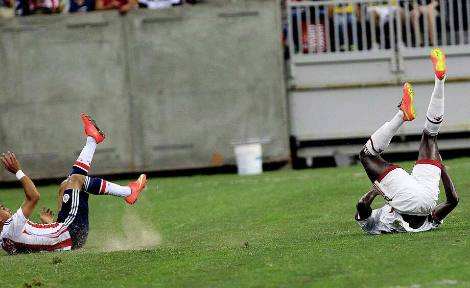Chivas midfielder Jesus Sanchez (17) and A.C. Milan forward Mbaye Niang (19) roll onto the ground after battling for the call as A.C. Milan defeated Chivas de Guadalajara 3-0 in an international friendly soccer game at NRG Stadium Wednesday, Aug. 6, 2014, in Houston. Photo: Johnny Hanson, Houston Chronicle / © 2014  Houston Chronicle