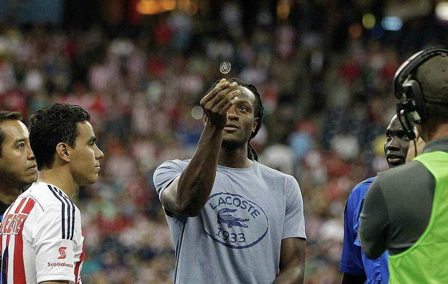 The Houston Texans DeAndre Hopkins participates in the coin toss before A.C. Milan defeated Chivas de Guadalajara 3-0 in an international friendly soccer game at NRG Stadium Wednesday, Aug. 6, 2014, in Houston. Photo: Johnny Hanson, Houston Chronicle / © 2014  Houston Chronicle