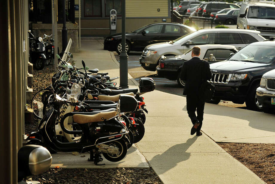 Scooters sit chained up at the Darien train station Wednesday. Photo: Jason Rearick / Stamford Advocate