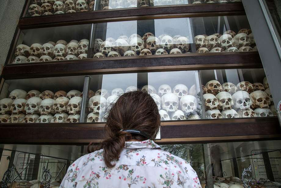 """Life sentences for genocide:Dozens of skulls of victims of the Khmer Rouge fill the windows of the main stupa at Choeung Ek   Killing Fields in Phnom Penh, Cambodia. Cambodia's U.N.-backed court on Thursday convicted two   former Khmer Rouge leaders - Nuon Chea, also known as """"Brother Number Two,"""" and Khieu Samphan, the   former head of state - and sentenced them to life in prison. Nearly 2 million people died from   forced labor, starvation, torture and execution during Pol Pot's reign of terror from 1975-79. Photo: Omar Havana, Getty Images"""