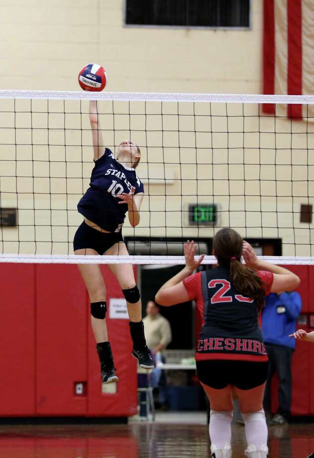 Staples High School's #10 Amelia Brackett towers over the net during the Class LL Finals against Cheshire High School in Berlin on Saturday.  Staples would lose 3-1. Photo: Mike Ross / Mike Ross Connecticut Post freelance - @www.mikerossphoto.com