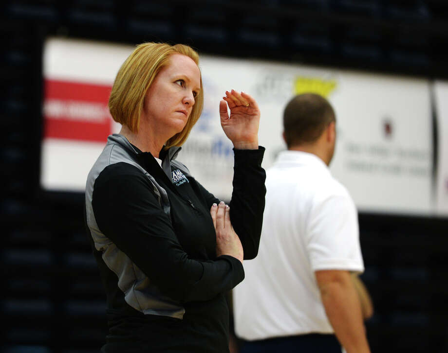 Head Coach Jessica Callahan motions to a player during practice Wednesday. The Lamar State College-Port Arthur volleyball team hosted a media day at the Carl A. Parker Multipurpose Center on Wednesday afternoon. Photo taken Wednesday 8/6/14 Jake Daniels/@JakeD_in_SETX Photo: Jake Daniels / ©2014 The Beaumont Enterprise/Jake Daniels
