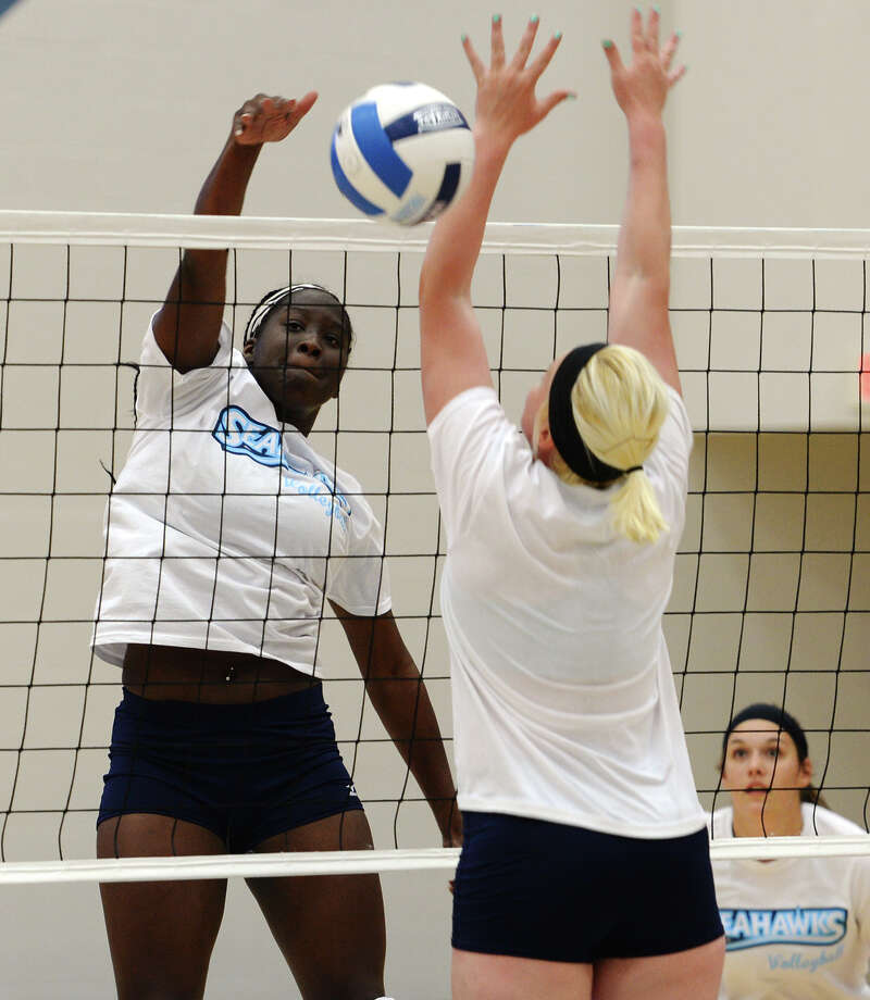 Rondaysha Thomas, back, puts the ball over the net as Kristina Merka moves to intercept. The Lamar State College-Port Arthur volleyball team hosted a media day at the Carl A. Parker Multipurpose Center on Wednesday afternoon. Photo taken Wednesday 8/6/14 Jake Daniels/@JakeD_in_SETX Photo: Jake Daniels / ©2014 The Beaumont Enterprise/Jake Daniels