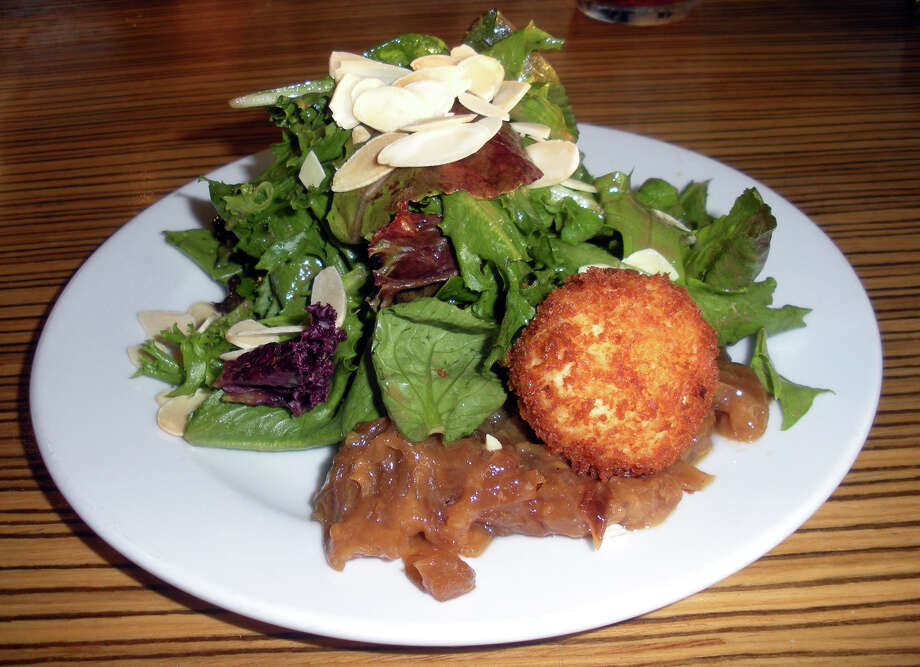 Baby field greens salad with fried goat cheese ball at 121 Restaurant at the Waterbury-Oxford Airport, 7 Juliano Drive, Oxford. Photo: Eileen Fischer / Connecticut Post