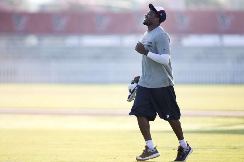 Texans wide receiver Andre Johnson jogs onto the practice field.