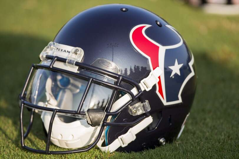 A Texans helmet sits on the practice field.