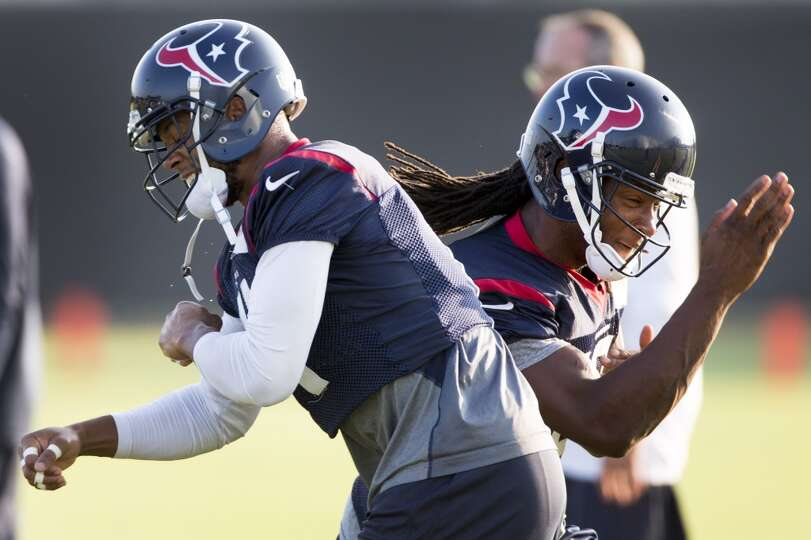 Texans wide receivers DeVier Posey, left, and DeAndre Hopkins, right, run a pass route drill.