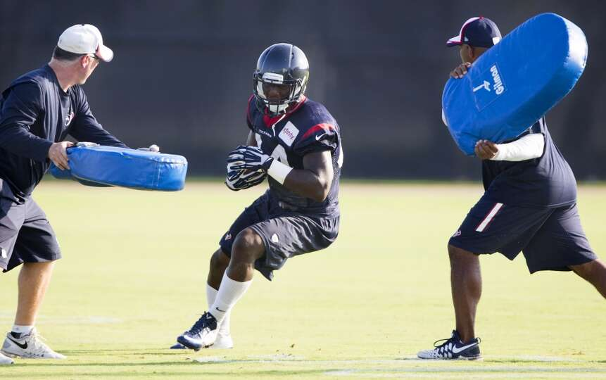 Texans running back Alfred Blue runs with the football after making a catch.