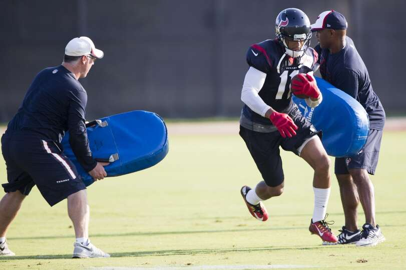 Texans wide receiver DeVier Posey (11) runs with the football after making a catch.