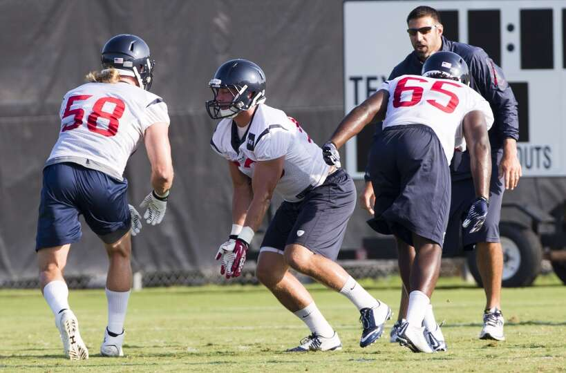 Texans linebackers Brooks Reed (58), Max Bullough (53) and Jason Ankrah (65) run a drill.