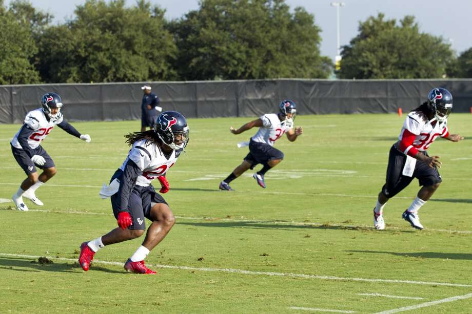 Texans defensive backs Kendrick Lewis (21), Jawanza Starling (29), Shiloh Keo (31) and D.J. Swearinger (36) run a drill. Photo: Brett Coomer, Houston Chronicle