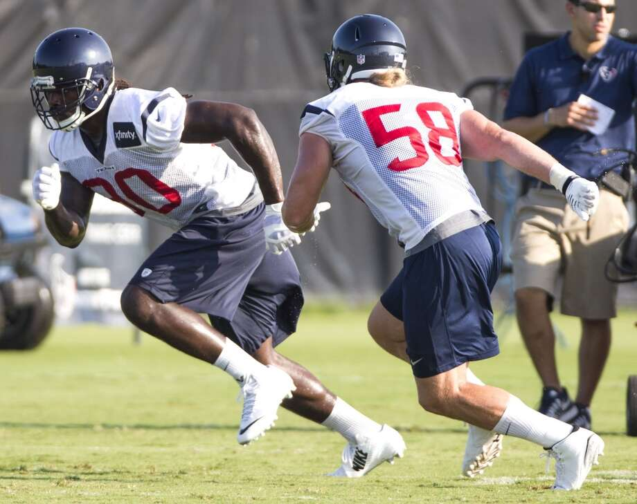 Texans linebacker Jadeveon Clowney (90) runs a pass rush drill with outside linebacker Brooks Reed (58). Photo: Brett Coomer, Houston Chronicle