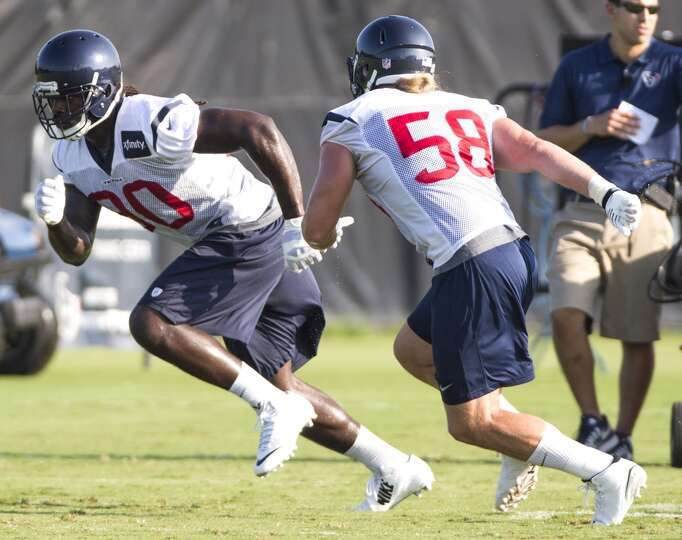 Texans linebacker Jadeveon Clowney (90) runs a pass rush drill with outside linebacker Brooks Reed (