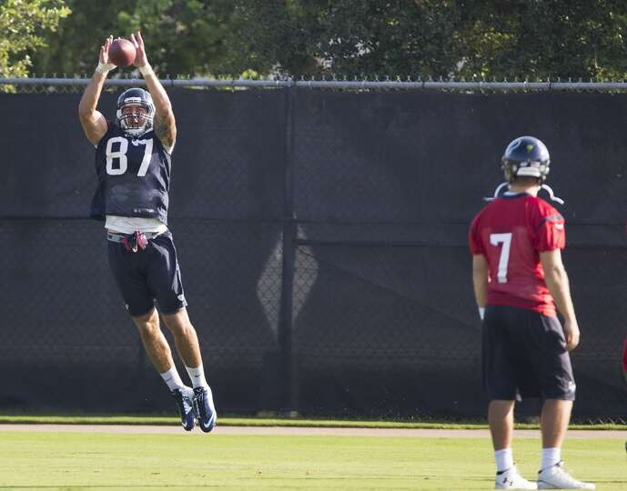 Texans tight end C.J. Fiedorowicz (87) leaps to make a catch with quarterback Case Keenum looking on