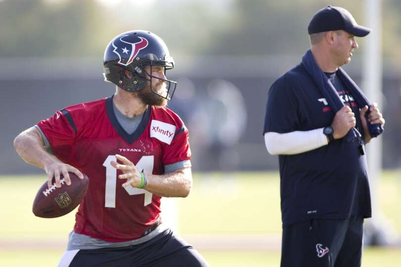 Texans quarterback Ryan Fitzpatrick (14) drops back to pass with head coach Bill O'Brien looking on.