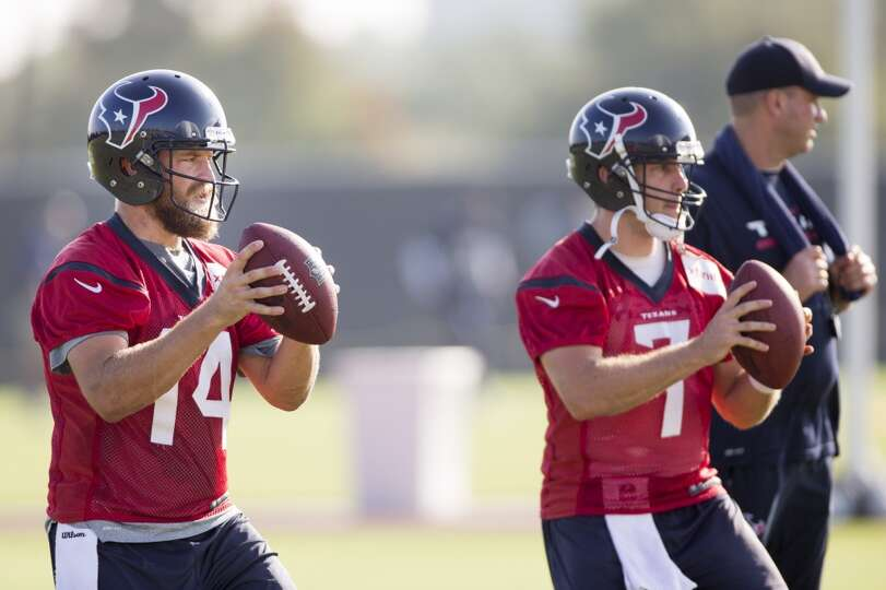 Texans quarterbacks Ryan Fitzpatrick (14) and  Case Keenum (7) drop back to pass.