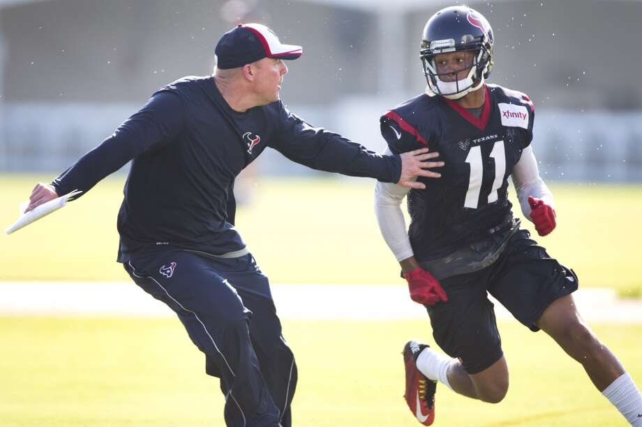 Texans quarterbacks coach George Godsey, left, covers wide receiver DeVier Posey (11) on a pass route in the end zone. Photo: Brett Coomer, Houston Chronicle