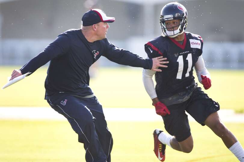 Texans quarterbacks coach George Godsey, left, covers wide receiver DeVier Posey (11) on a pass rout