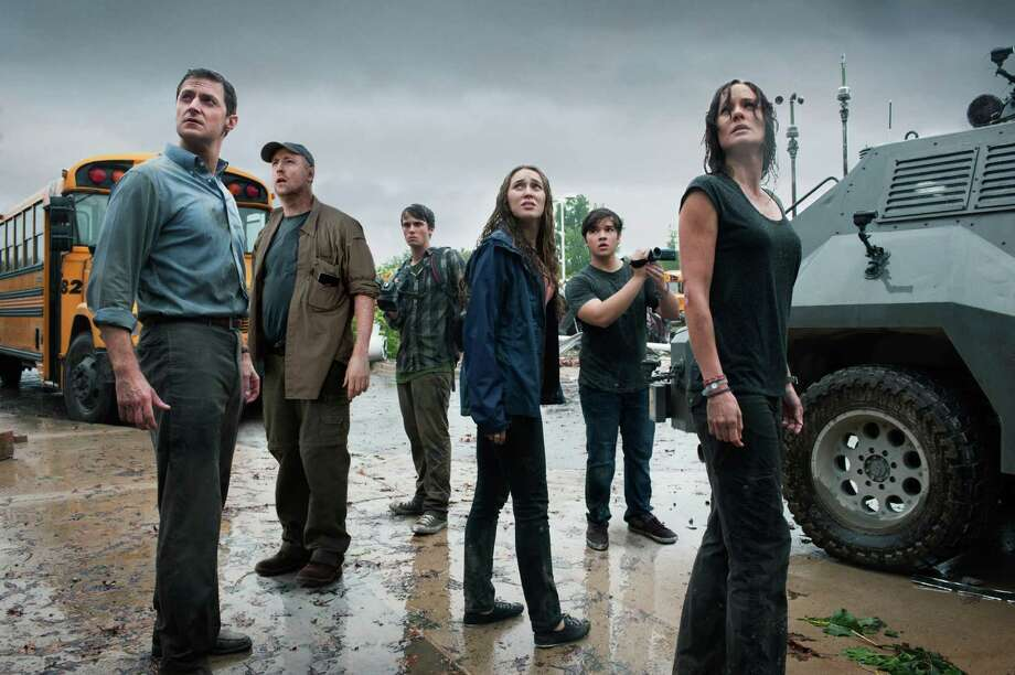 "Ron Phillips Caption: (L-r) RICHARD ARMITAGE as Gary, MATT WALSH as Pete, MAX DEACON as Donnie, ALYCIA DEBNAM-CAREY as Kaitlyn, NATHAN KRESS as Trey and SARAH WAYNE CALLIES as Allison in New Line Cinema's and Village Roadshow Pictures' thriller ""INTO THE STORM,"" a Warner Bros. Pictures release.    Ph: Ron Phillips  © Warner Bros. Entertainment Inc. All Rights Reserved. Photo: Ron Phillips / © Warner Bros. Entertainment Inc. All Rights Reserved."