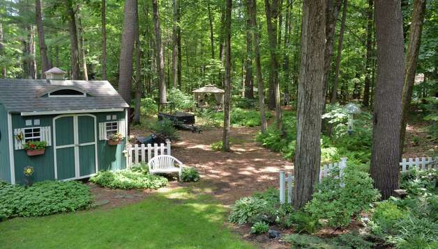 Entrance to Tony and Judy Eastwood's woodland garden Wednesday July 2, 2014, in the backyard of their home in Saratoga Springs, NY.  (John Carl D'Annibale / Times Union) Photo: John Carl D'Annibale / 00027577A