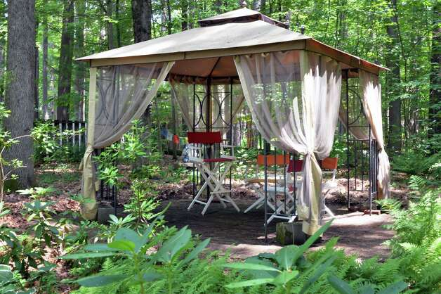 the gazebo in Tony and Judy Eastwood's woodland garden Wednesday July 2, 2014, in the backyard of their home in Saratoga Springs, NY.  (John Carl D'Annibale / Times Union) Photo: John Carl D'Annibale / 00027577A