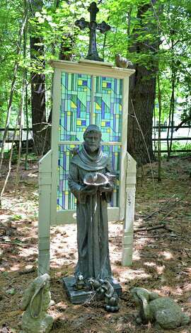 A statue of St. Francis in Tony and Judy Eastwood's woodland garden Wednesday July 2, 2014, in the backyard of their home in Saratoga Springs, NY.  (John Carl D'Annibale / Times Union) Photo: John Carl D'Annibale / 00027577A