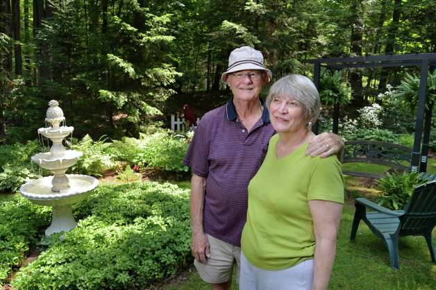 Tony and Judy Eastwood in their backyard garden Wednesday July 2, 2014, in Saratoga Springs, NY.  (John Carl D'Annibale / Times Union) Photo: John Carl D'Annibale / 00027577A