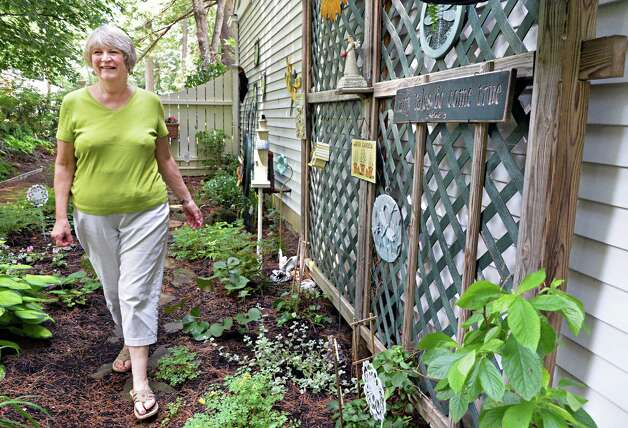 Judy Eastwood in her faery garden Wednesday July 2, 2014, at her home in Saratoga Springs, NY.  (John Carl D'Annibale / Times Union) Photo: John Carl D'Annibale / 00027577A