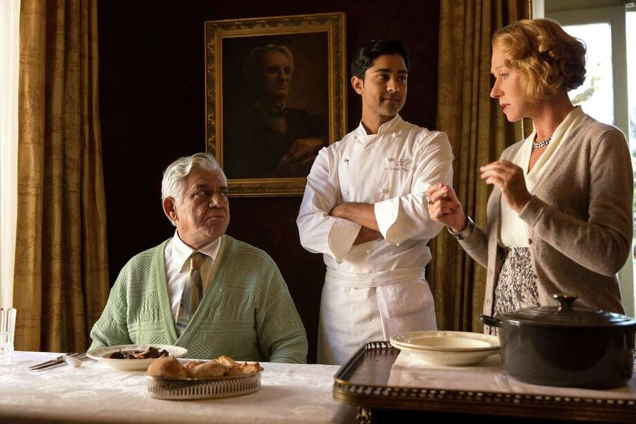 "This image released by DreamWorks II shows, from left, Om Puri, Manish Dayal and Helen Mirren in a scene from ""The Hundred-Foot Journey."" (AP Photo/Francois Duhamel, DreamWorks II) ORG XMIT: NYET195 Photo: Francois Duhamel / DreamWorks II"