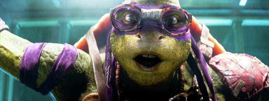 "This image released by Paramount Pictures shows the character Donatello from ""Teenage Mutant Ninja Turtles."" The live-action reimagining of the 30-year-old comic book franchise out Friday features a completely computerized version of the sewer-dwelling superheroes, a take more akin to Gollum from ""The Lord of the Rings"" films or Caesar from the recent ""Planet of the Apes"" movies than the rubbery renditions from the 1990s films. For the reboot, the performers physically portraying the Ninja Turtles donned skintight grey getups and shell-shaped backpacks, while helmets equipped with cameras captured their facial expressions. Everything was later replaced on screen with hulking, emoting green avatar.  (AP Photo/Paramount Pictures, Industrial Light & Magic) ORG XMIT: NYET208 Photo: Industrial Light & Magic / Paramount Pictures"