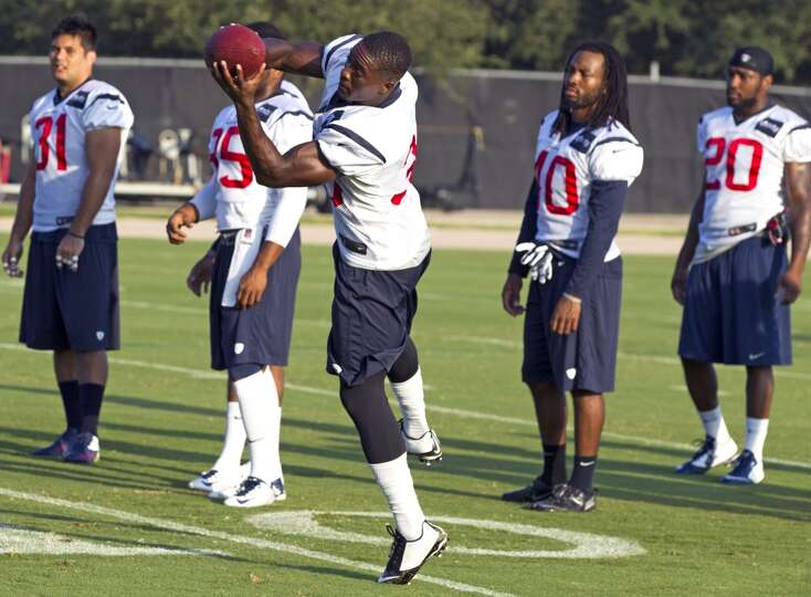 Texans defensive back Andre Hal (38) catches a football.