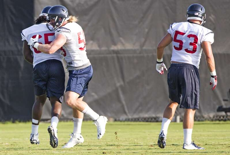 Texans linebackers Jason Ankrah (65), Brooks Reed (58) and Max Bullough (53) run a drill.