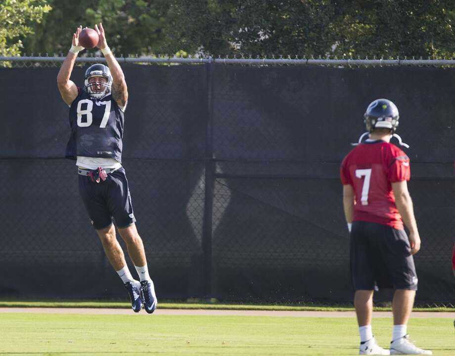 Texans tight end C.J. Fiedorowicz (87) leaps to make a catch with quarterback Case Keenum looking on. Photo: Brett Coomer, Houston Chronicle