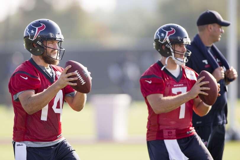 Texans quarterbacks Ryan Fitzpatrick (14) and  Case Keenum (7) drop back to pass.
