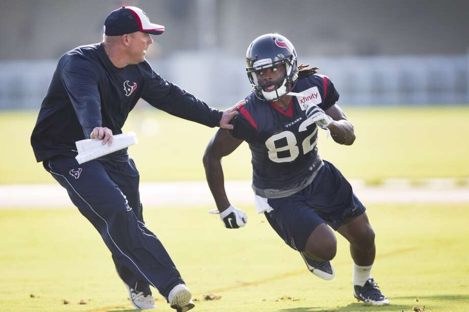 Texans quarterbacks coach George Godsey, left, covers wide receiver Keshawn Martin (82) on a pass route in the end zone. Photo: Brett Coomer, Houston Chronicle