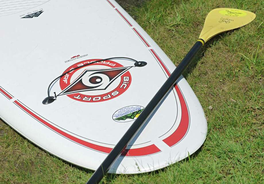 Close up of a paddleboard and oar at Fish Creek Marina on Wednesday, Aug. 6, 2014 in Saratoga Springs, N.Y. Fish Creek Marina is located on the outlet of Saratoga Lake on the Fish Creek  (Lori Van Buren/Times Union) ORG XMIT: ALB1408061703391965 Photo: Lori Van Buren / 00028059A